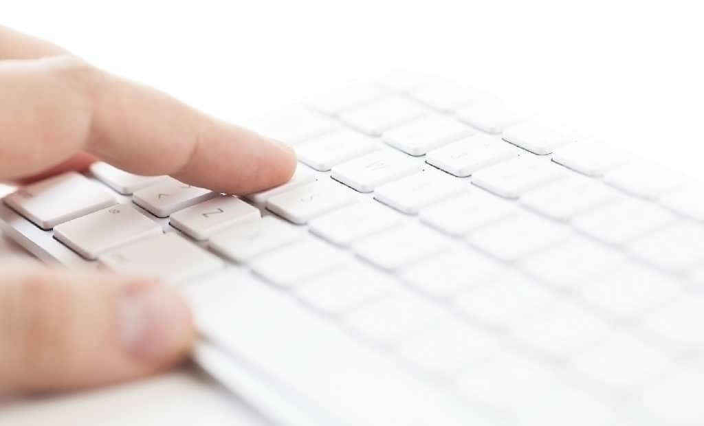 A person typing on a keyboard